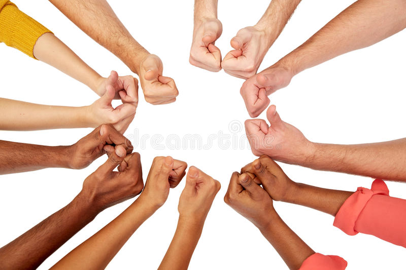 Hands of international people showing thumbs up. International, diversity, race, ethnicity and people concept - hands showing thumbs up over white background royalty free stock images