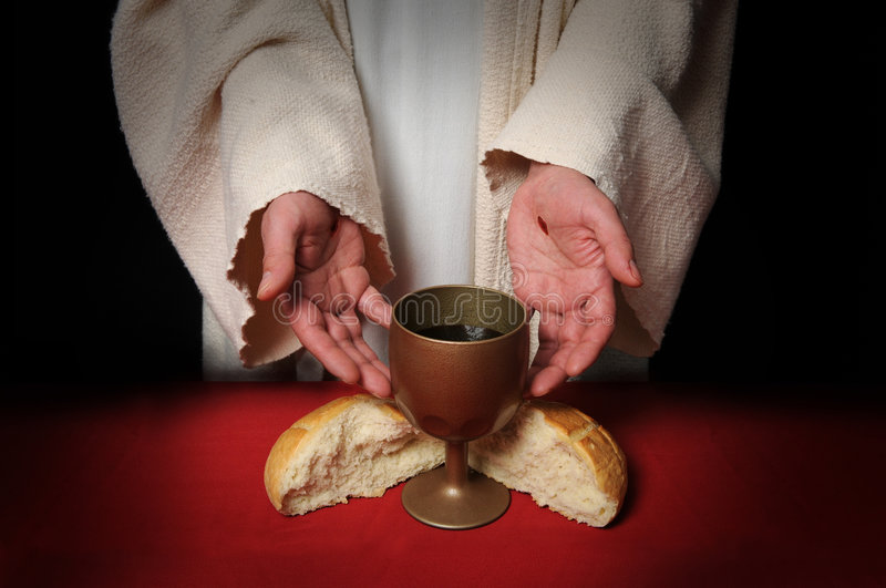 Hands of Jesus and Communion. The hands of Jesus offering the Communion wine and bread