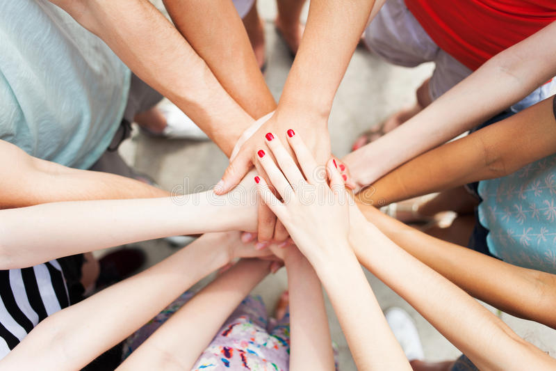 Hands joined in unity. Circle of hands joined in unity