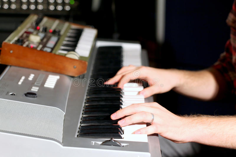 Hands on keyboard of electric organ stock photo