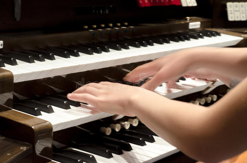 Hands on keyboard of organ stock image