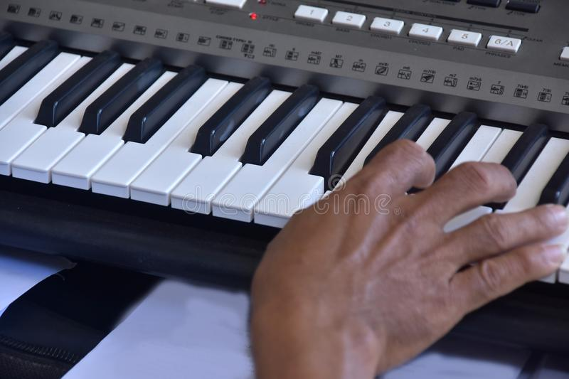 Hands of a keybord player during a live performance. Real zise royalty free stock photography