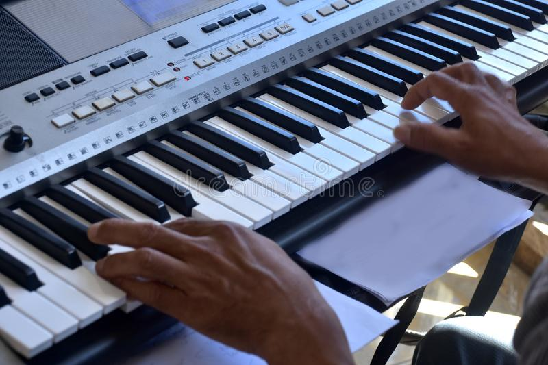 Hands of a keybord player during a live performance. Real zise stock photos