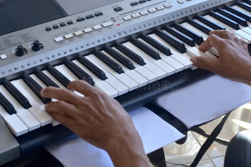 Hands of a keybord player during a live performance. Real zise royalty free stock image