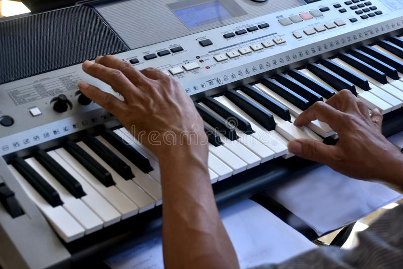 Hands of a keybord player during a live performance. Real zise stock photography