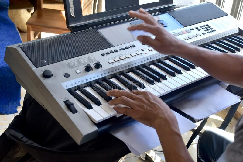 Hands of a keybord player during a live performance. Real zise royalty free stock photos