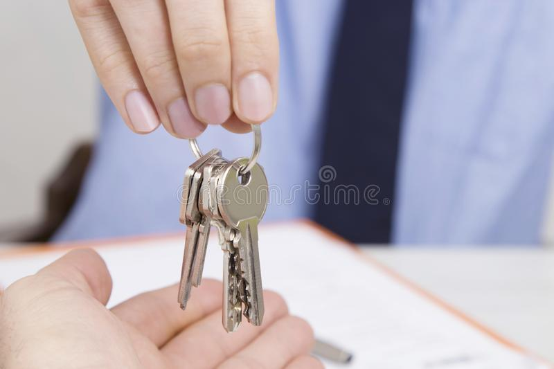 Concept of buying or renting house. Hands with keys, concept of buying or renting house or apartment royalty free stock photo