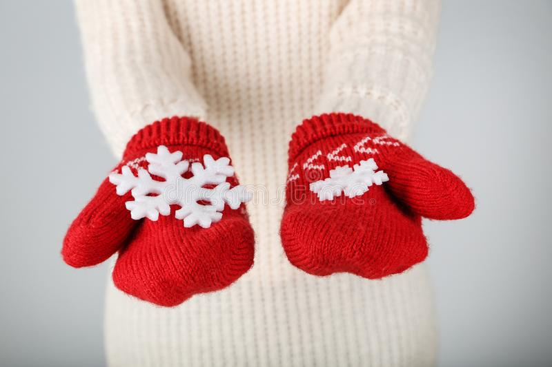 Hands in mittens holding snowflakes royalty free stock photography