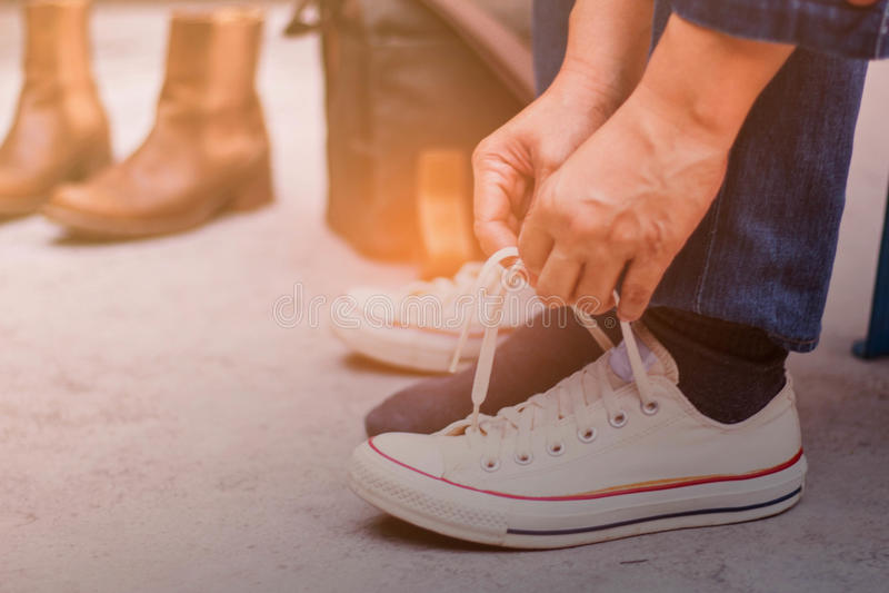 Hands are laced sneakers. Hands are laced sneakers on the concrete royalty free stock photos