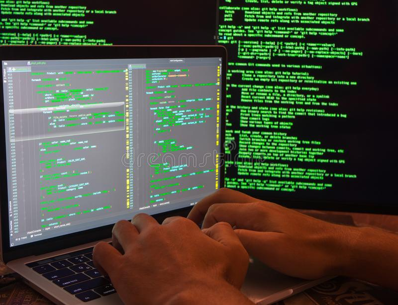 Hands on laptop keyboard. Man on coding. Cybersecurity. Hacker looking for backdoors and exploiting vulnerability. Man on coding. Hands typing royalty free stock photos