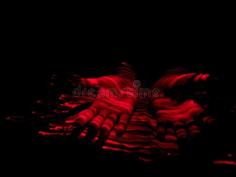 Hands 2.0. Light painted image of hands created using longexposure and lightpainting royalty free stock photography
