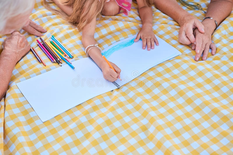 Hands of little girl drawing. royalty free stock image