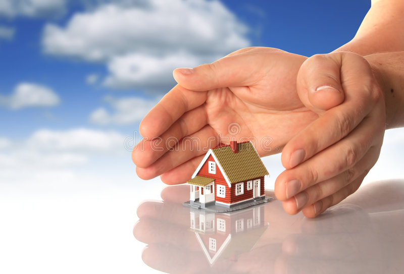 Hands and little house. royalty free stock photography