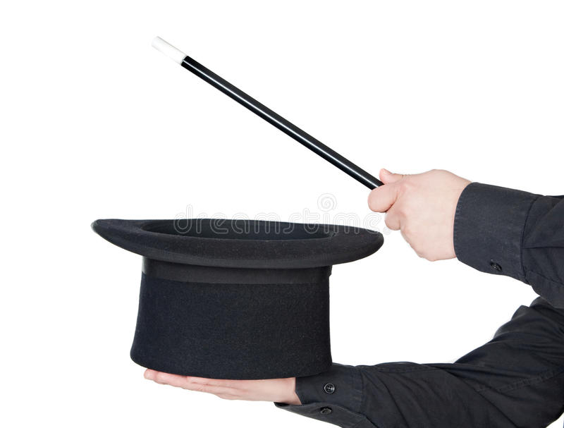 Hands of the magician with magic wand and top hat royalty free stock image