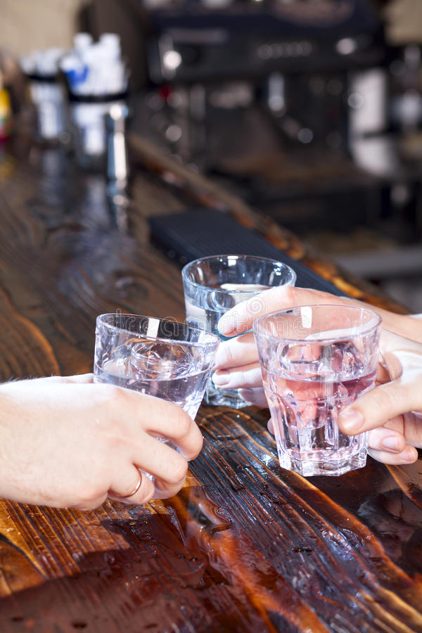 Hands make cheers with glasses royalty free stock photos
