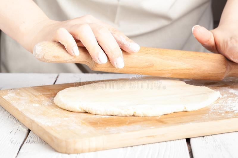 Hands making dough on kitchen, close up view royalty free stock photo