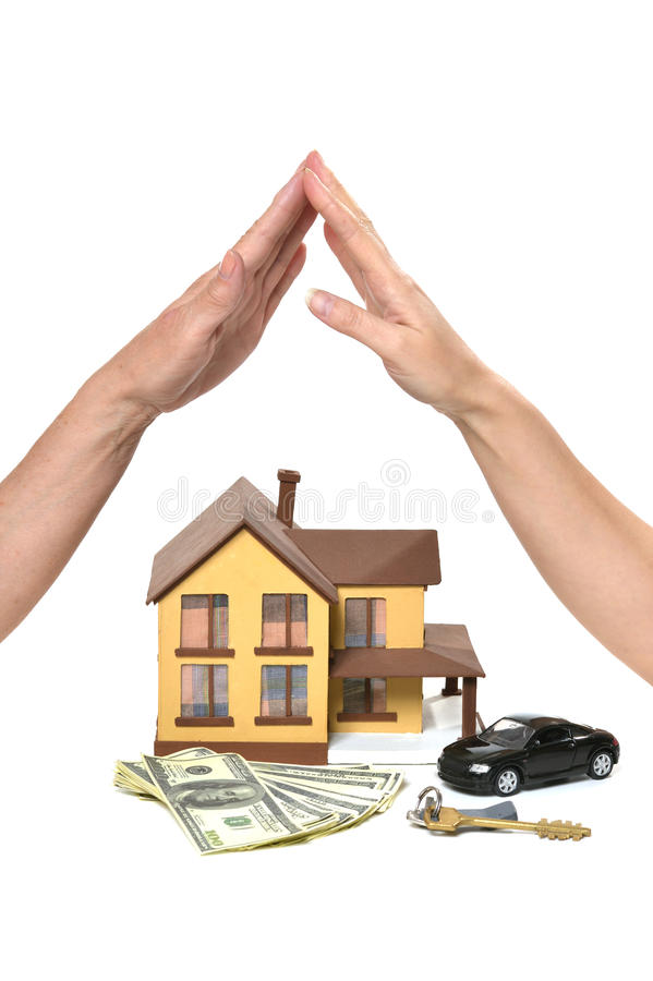 Hands making roof. Real estate concept. hands making roof over miniature house isolated on white background royalty free stock photos