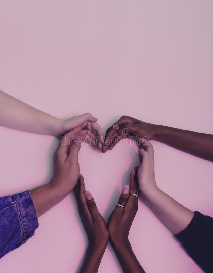 Hands making shape of heart stock photo