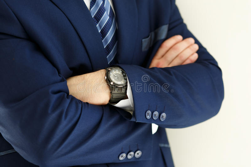 Hands of male businessman in blue suit crossed on chest royalty free stock photos