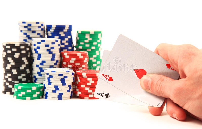 Hands Of A Man With A Card And Poker Chips Stock Images