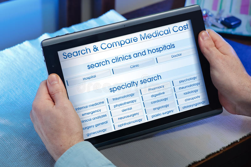 Hands of a man consulting a website of online health service in. Man searching web internet for recruitment health insurance on internet with tablet in you home stock image