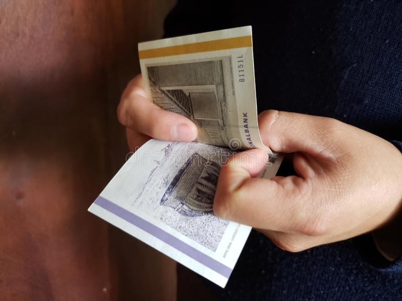 Hands of a man counting danish banknotes. Commerce, exchange, trade, trading, value, buy, sell, profit, price, rate, cash, currency, paper, money, economic royalty free stock photos