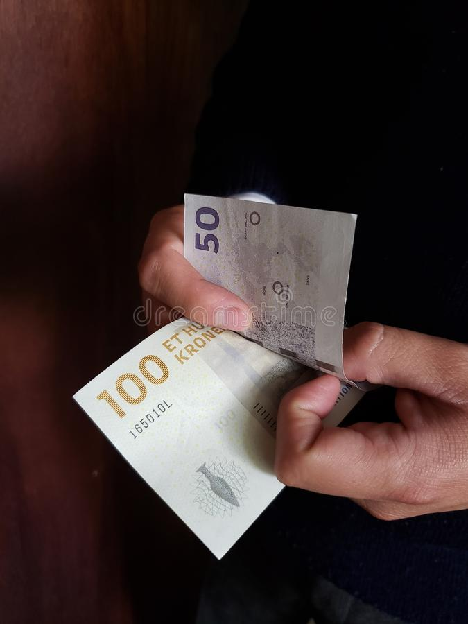 Hands of a man counting danish banknotes. Commerce, exchange, trade, trading, value, buy, sell, profit, price, rate, cash, currency, paper, money, economic stock photography