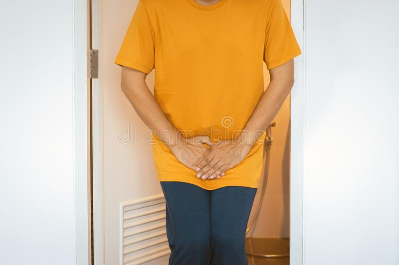 Hands man holding his crotch,Male need to pee,Urinary incontinence,Close up. Hand men holding his crotch,Male need to pee,Urinary incontinence,Close up stock photo