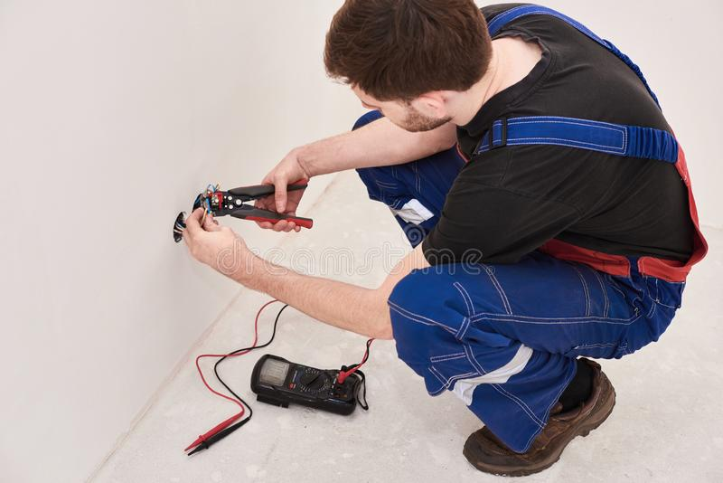 Crimping pliers on the man hands. installation, repairs in the new flat royalty free stock photo