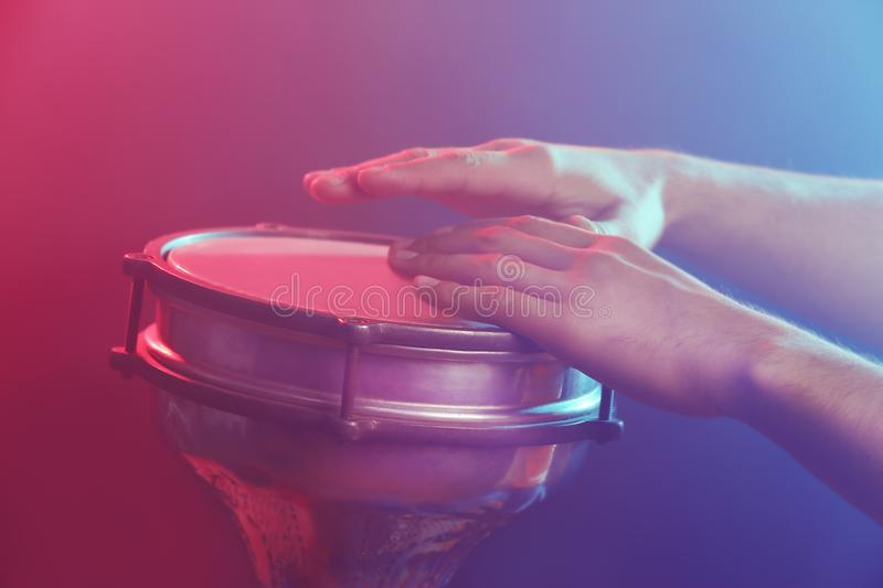 Hands of man playing African drum royalty free stock photography