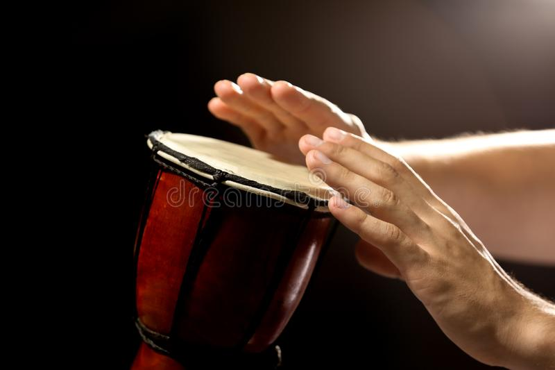 Hands of man playing African drum royalty free stock photos
