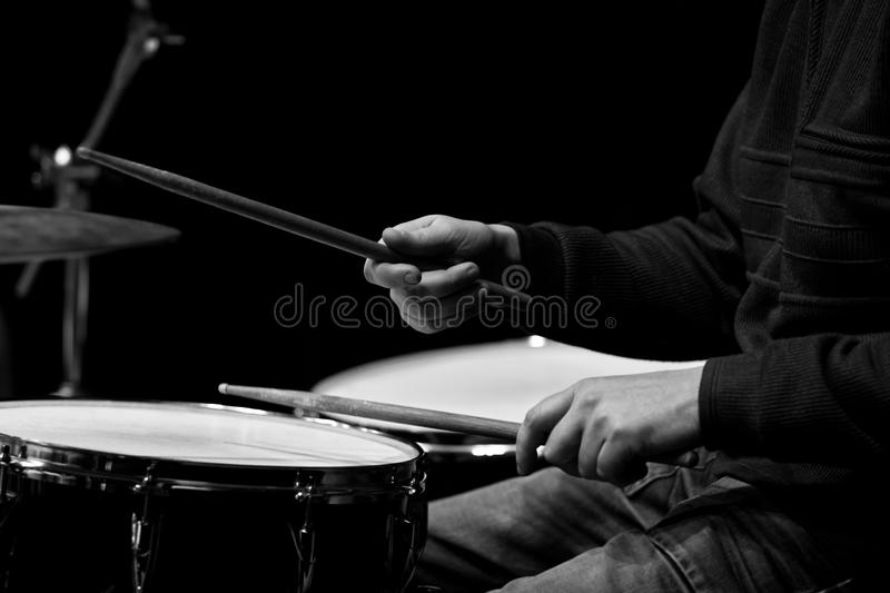 Hands of a man playing a drum kit royalty free stock photography