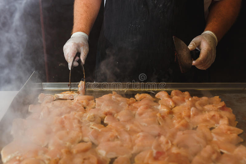 Hands of man take cooking of chicken meat royalty free stock photos