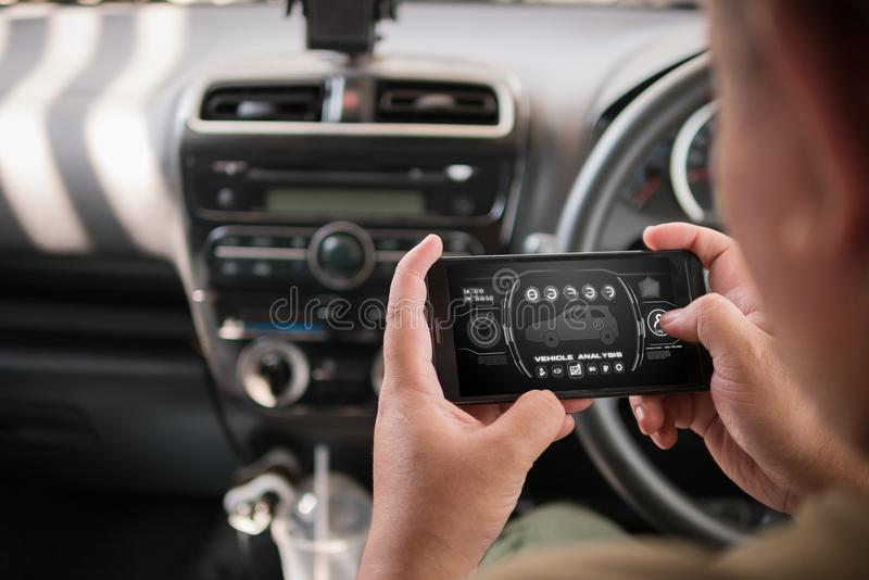 Hands of man using mobile smart phone vehicle analysis appiication in the car for mobile technology application concept stock images