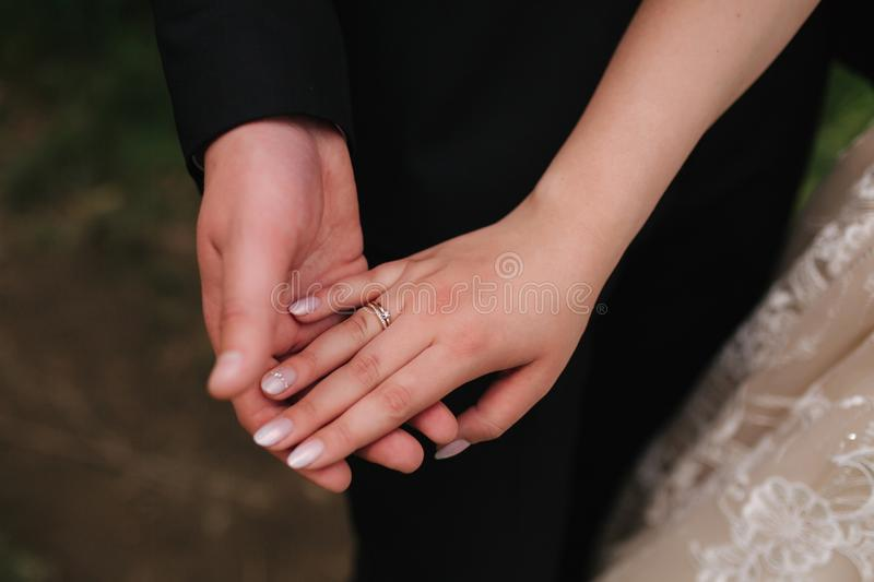 Hands of man and woman. Close up of couples hands`s stock image