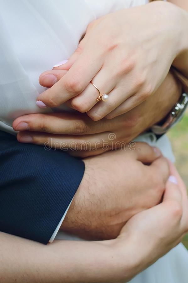 Hands of a man and a woman, close-up. Embrace, love, wedding. Vertical photography stock image