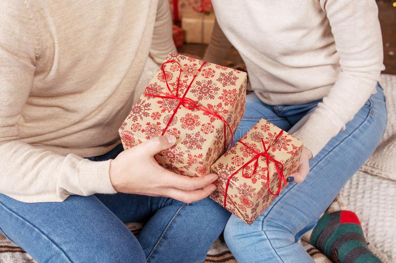 Hands of man and woman holding a Christmas gift boxes.  Christmas, new year, birthday concept.  Magic fairy tale stock image