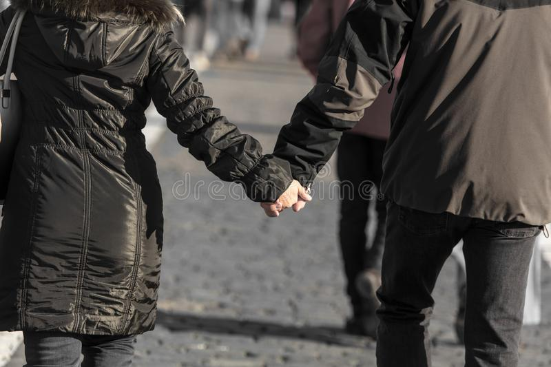 Hands of a man and a woman in a park royalty free stock image