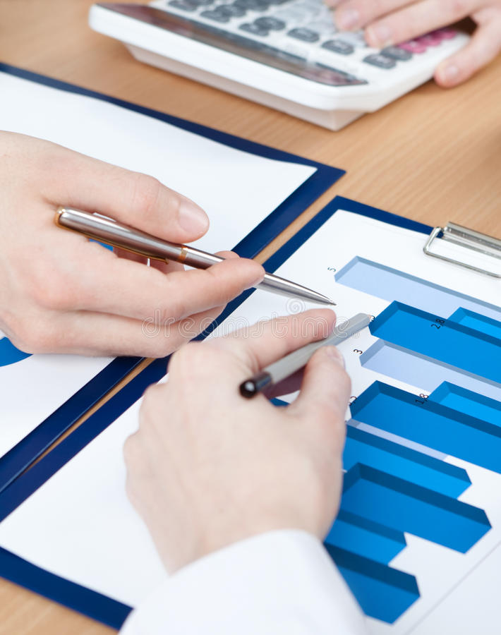 Download Hands Of Managers Discussing Diagram Stock Image - Image: 26880691