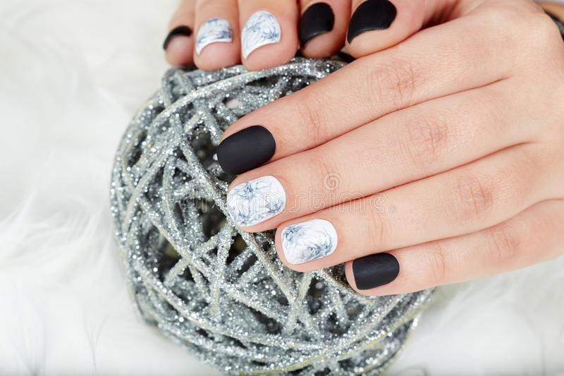 Hands With Manicured Nails Colored With Black And White Nail Polish ...
