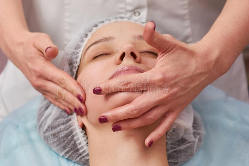 Hands massaging face close up. royalty free stock photo