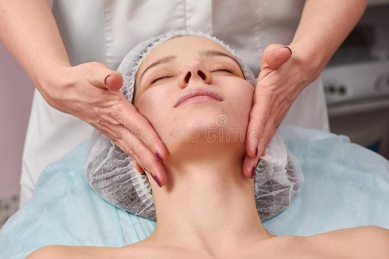 Hands massaging female face. royalty free stock photo