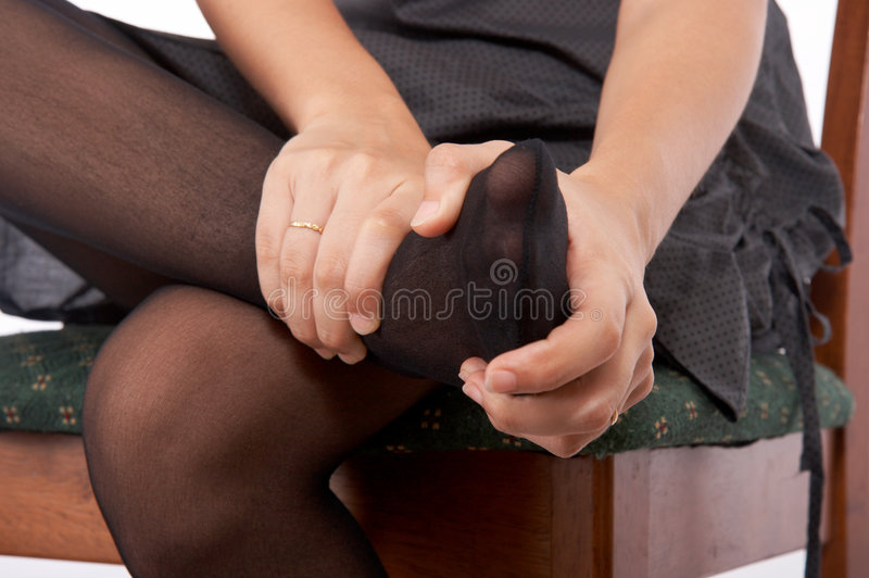 Hands massaging a foot royalty free stock images