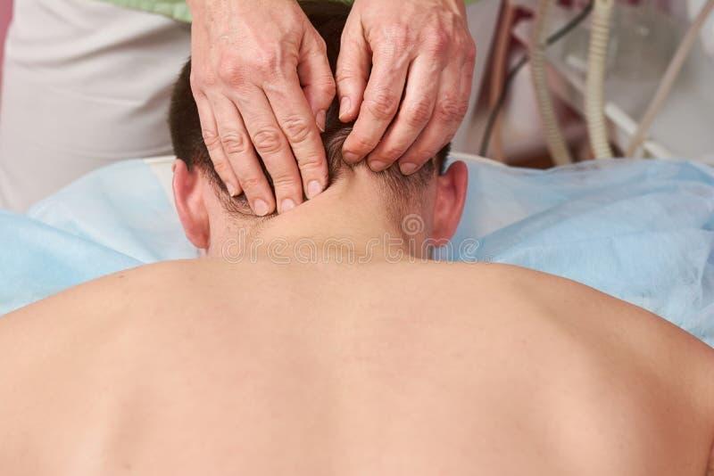 Hands massaging neck close up. Person having neck massage stock photos