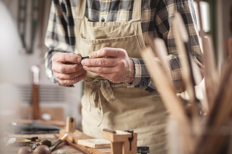 Hands of a mature carpenter royalty free stock photos