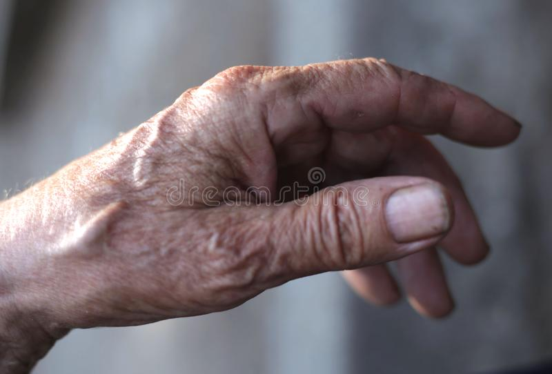 The hands of men who worked for many years. The hands of men who have worked for many years, the hand that has been at work for many years, the hand for stock photo