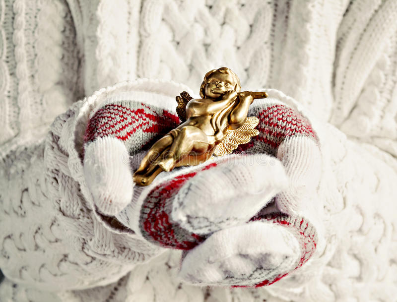Hands in mittens hold Christmas vintage angel close-up royalty free stock photos
