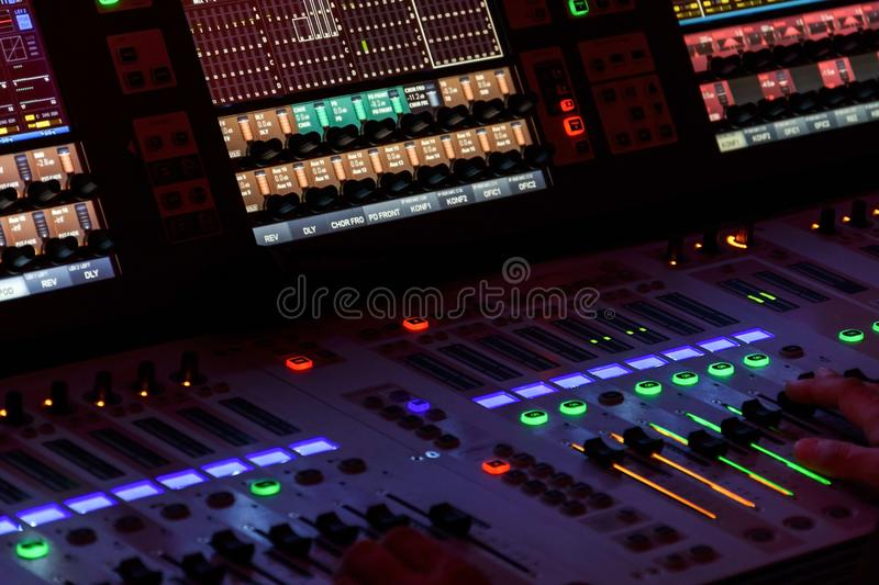 Hands on Mixing Console. Director working on the video or sound mixing console in the studio royalty free stock images