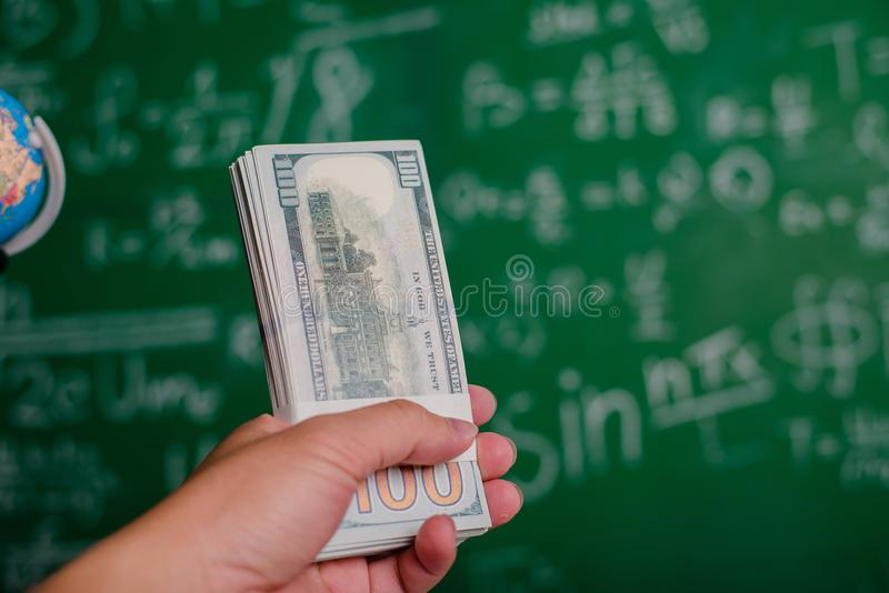 Hands and money dollars Hands and money dollars Successful jobseekers and financiers and career advancement. stock photos