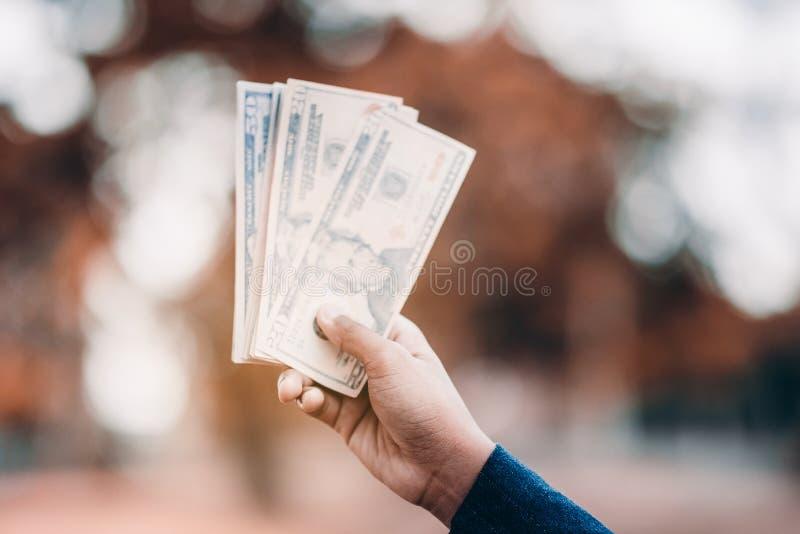 Hands and money of financiers stock image